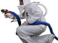 Tyvex-w-hood-kneeling-w-gun-profile-shot-cleaned-small-200x150